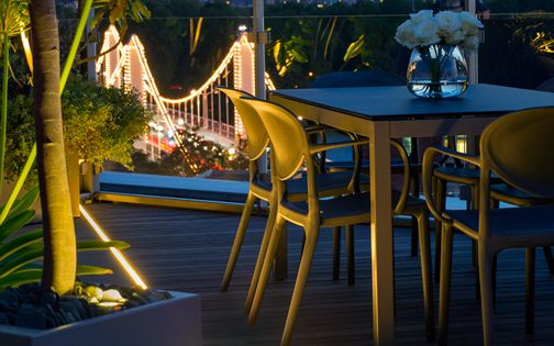 modern roof terrace low round seats with striking planting