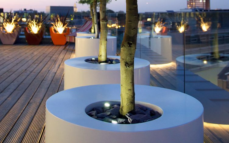 large circular roof garden tree planters