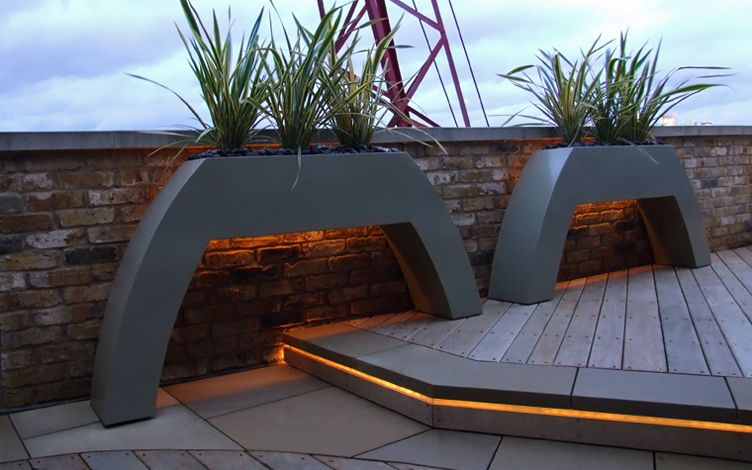 curved hollowed floating roof terrace planters