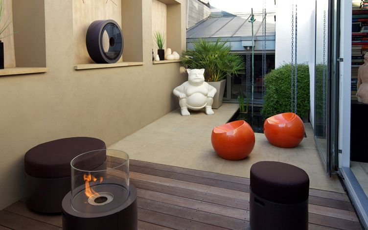 modern garden seating area with fire